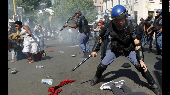 Student protesters in Johannesburg run for cover as police try to disperse them on Wednesday, September 21. Protests turned violent over an increase in South Africa's university fees.
