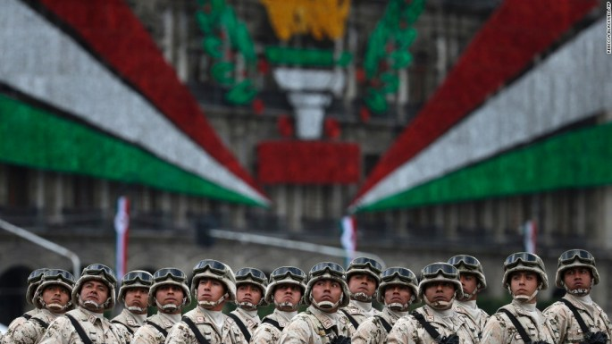 Mexican soldiers look up toward their President during the Independence Day military parade on Friday, September 16.
