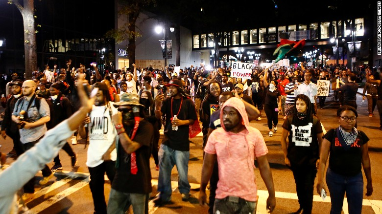 Residents and activists march in the streets of Charlotte on September 22. There was a heavy police presence, and the North Carolina National Guard was also on hand.