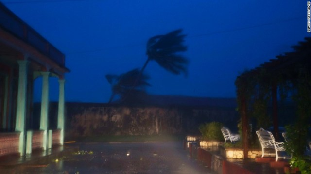 """The high winds of Hurricane Matthew roar over Baracoa, Cuba, on Tuesday, October 4. Matthew's strong winds <a href=""""http://www.cnn.com/2016/10/04/americas/hurricane-matthew/"""" target=""""_blank"""">pounded Cuba on Tuesday night </a>even as the powerful storm took its last lashes at Haiti, where it downed trees, drenched the ground with feet of rain and flooded streets."""