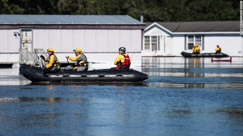 Rescue teams navigate floodwaters in Lumberton, North Carolina, on Monday, October 10. Hurricane Matthew caused flooding and damage in several U.S. states after slamming island nations in the Caribbean.