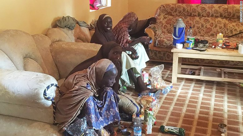 Some of the 21 freed girls appear Thursday in Banki, Nigeria, in a photo obtained exclusively by CNN.