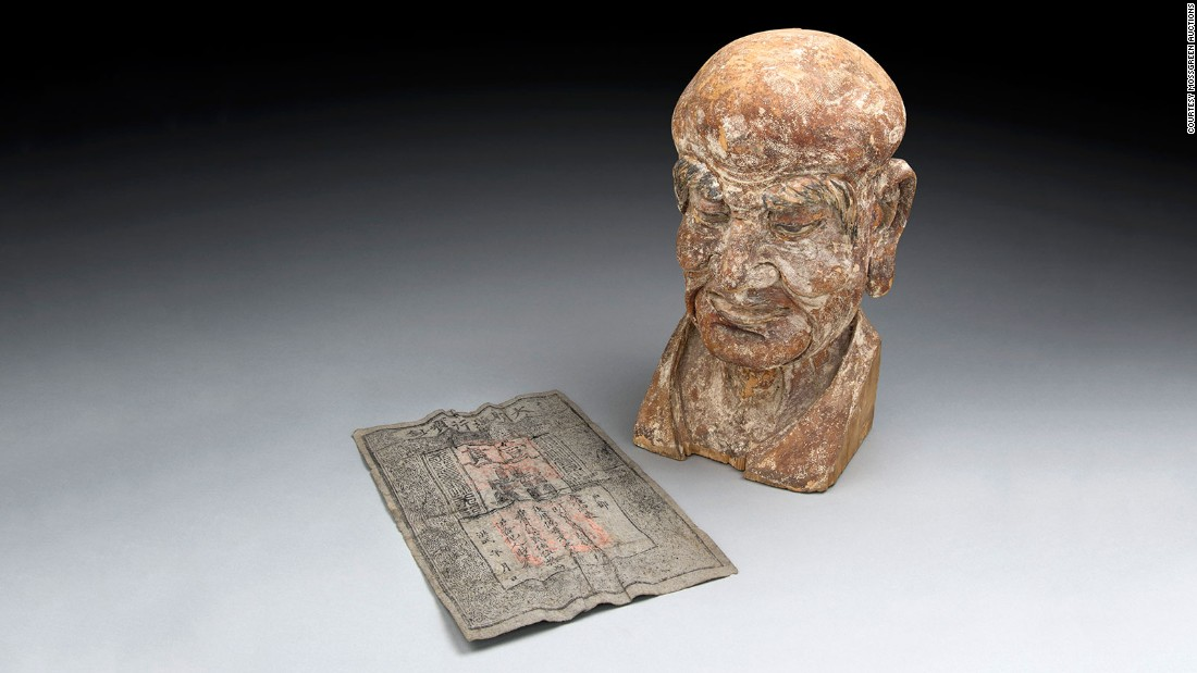 Specialists at Mossgreen auctions in Australia discovered this Ming dynasty banknote hidden inside the head of this 14th century Buddhist carving. The wooden sculpture represents the head of a Luohan -- an enlightened person who has reached Nirvana in Buddhist culture.