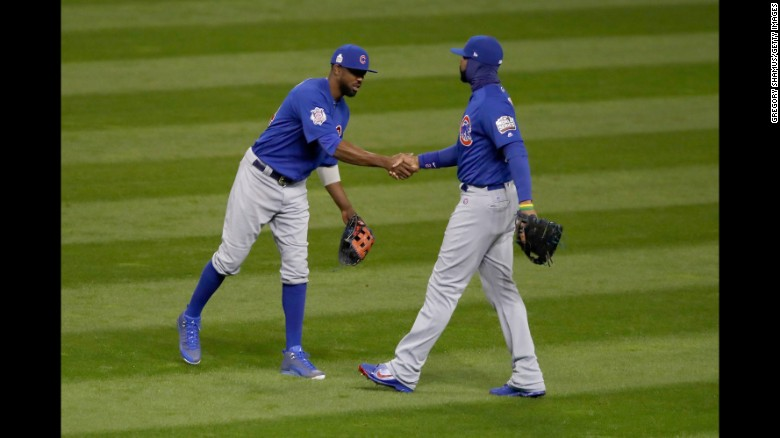 Dexter Fowler of the Chicago Cubs celebrates with Jason Heyward after defeating the Cleveland Indians 5-1 in Game 2 of the 2016 World Series on Wednesday, October 26, 2016 in Cleveland, Ohio.