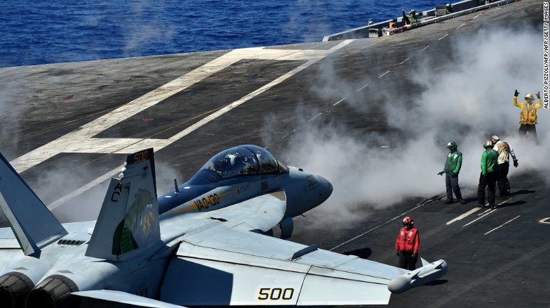 """An F/A-18F Super Hornet takes off from the US navy's super carrier USS Dwight D. Eisenhower (CVN-69) (""""Ike"""") in the Mediterranean Sea on July 7, 2016.  The US aircraft carrier is deployed in support of Operation Inherent Resolve, maritime security operations and theater security cooperation efforts in the US 6th Fleet area of operations. Air Wings embarked aboard conducted strikes against the terrorist group ISIL in Libya, Iraq and Syria.  / AFP / ALBERTO PIZZOLI        (Photo credit should read ALBERTO PIZZOLI/AFP/Getty Images)"""