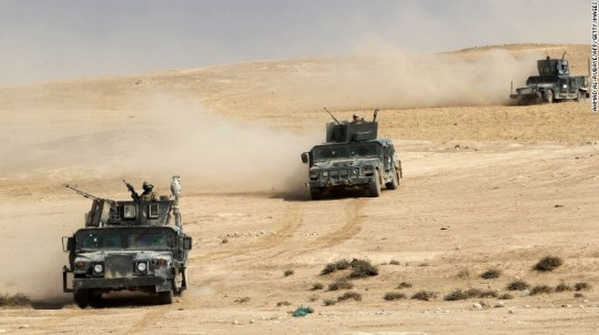 Iraqi forces advance towards the village of Sin al-Dhuban, south of Mosul, on Thursday