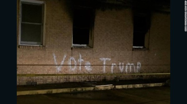 """The vandals also wrote """"Vote Trump"""" in crude, white spray paint across the church."""