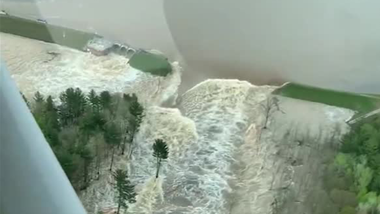 Stark images show how Michigan dam failure drained lake - CNN