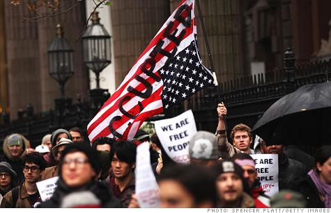 https://i0.wp.com/i2.cdn.turner.com/money/2011/11/21/news/occupy_wall_street_money/occupy-protesters.gi.top.jpg