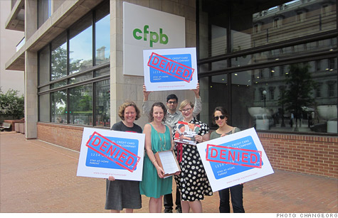 Holly McCall (in the green dress) is protesting a