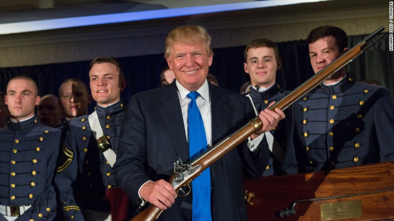 Image result for donald trump holding gun