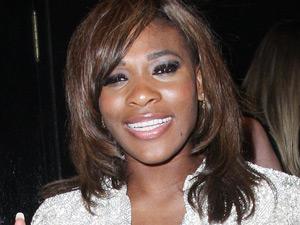 Serena Williams poses outside Whisky Mist nightclub