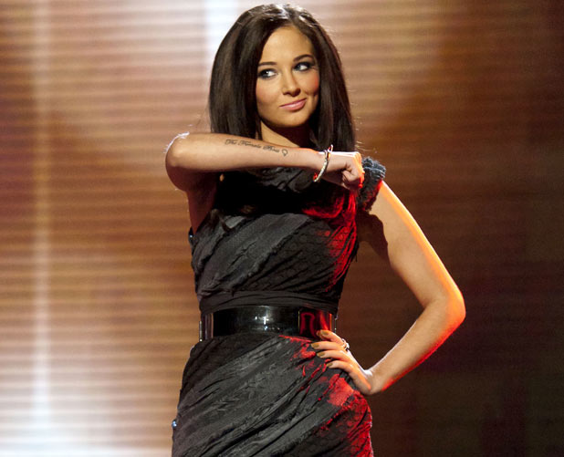 Tulisa shows her The Female Boss tattoo on The X Factor