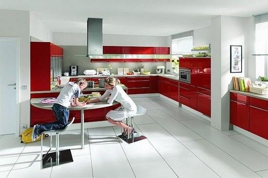 metal kitchen table sets roll out cabinet 为厨房添一抹红10款红色厨房装修设计 每日头条 配有椭圆形餐桌和移动置物架的厨房 可容纳多人用餐 是大家庭节日聚餐的理想场地 虽然餐桌椅的颜色 烹饪区的不锈钢金属颜色有点冷 不过 巧用中国红就能把这两处的
