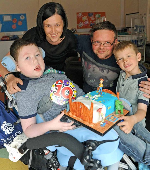 Conor Durkin-O'Brien celebrates his 10th birthday pictured at Alder Hey Hospital with mum Julianne dad Phil and younger brother Cameron