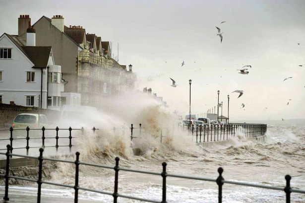 Pic Andrew Teebay. Merseyside hit by high winds. Waves hitting South Parade at West Kirby Marine Lake,during the high winds hitting the region