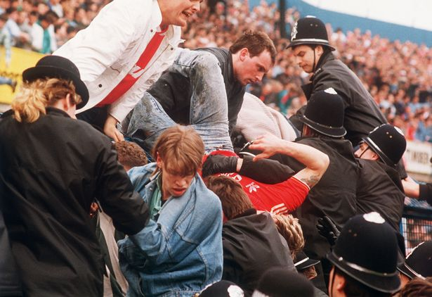 Some police officers help fans escape the crush at Hillsborough