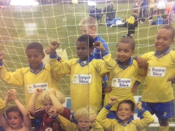 Rashford (second from left, back row) celebrates a Fletcher Moss tournament win in 2005