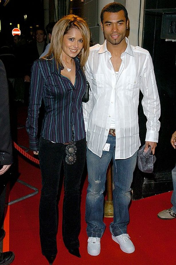 Cheryl Tweedy from Girls Aloud with Ashley Cole (Photo by J. Quinton/WireImage)