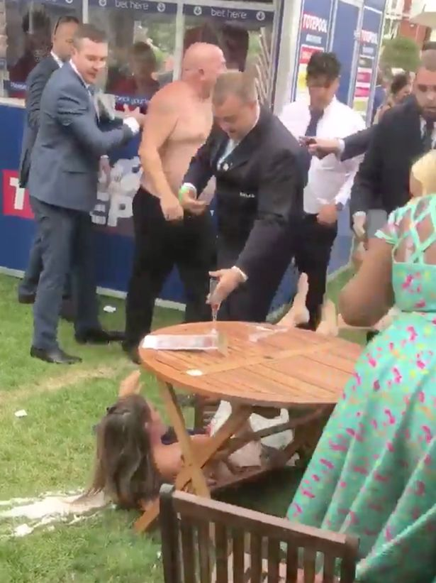 VIRAL FOOTAGE: Shirtless race-goer crashes through crowd to square up to punter at Royal Ascot