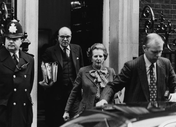 Former Prime Minister Margaret Thatcher leaves No 10 Downing Street for a parliamentary meeting during her time in office in 1983. She is followed by Ian Gow MP.