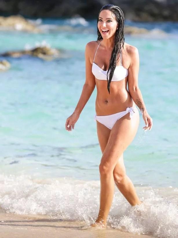 Tulisa Contostavlos wearing a white bikini on a beach in Bermuda
