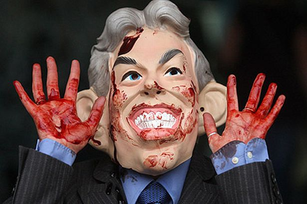 Protester dressed like Tony Blair with blood on his hands