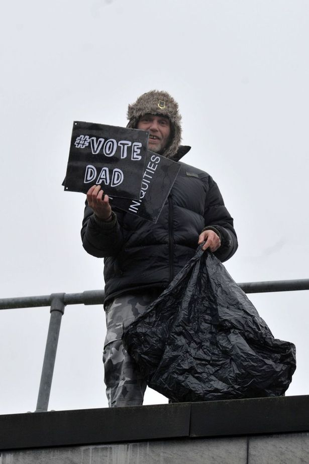 New Fathers 4 Justice Martin Matthews campaigner holds a rooftop protest at Redhill Magistrates' Court