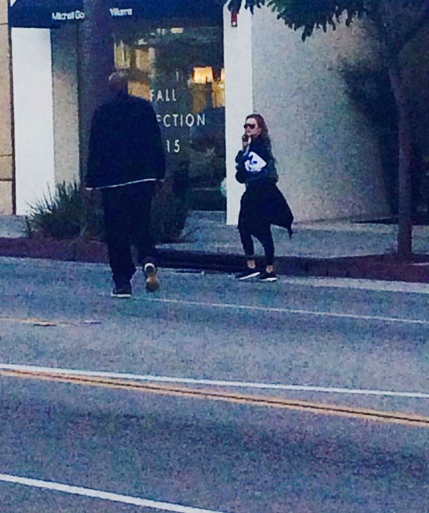 Lamar pictured approaching Khloe outside the gym