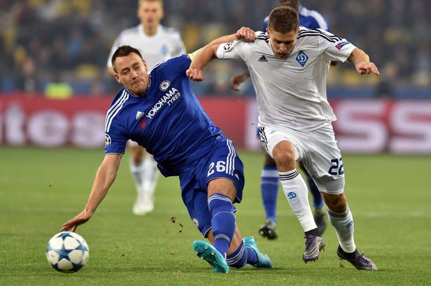 Artem Kravets fights for the ball with John Terry