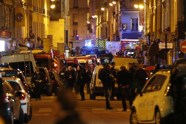 Police forces, firefighters and rescue workers secure the area near the Bataclan concert hall in central Paris, on November 14, 2015