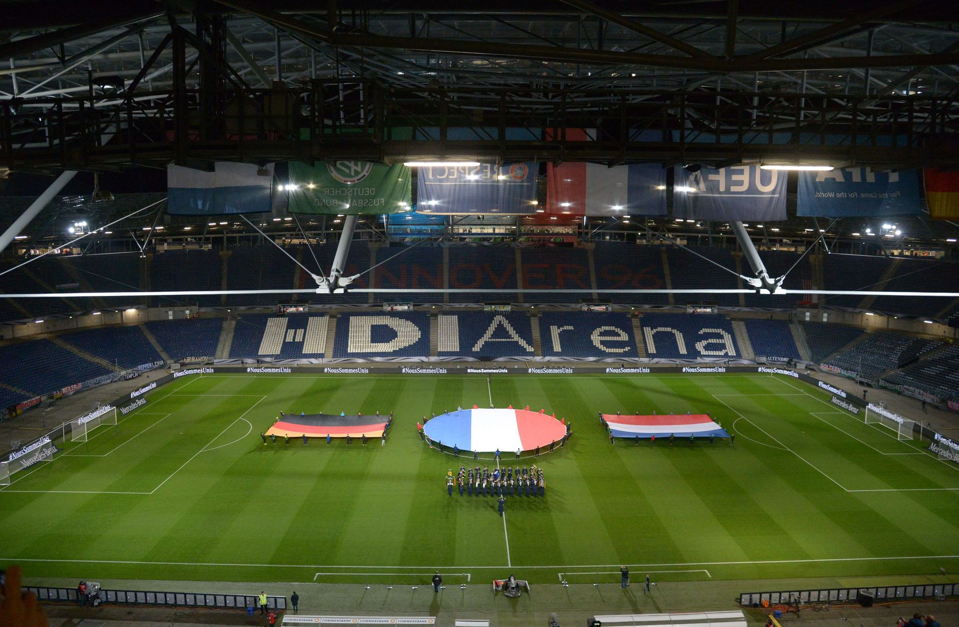 German French and Dutch flags are seen during a rehearsal prior to a friendly football match Germany vs the Netherlands
