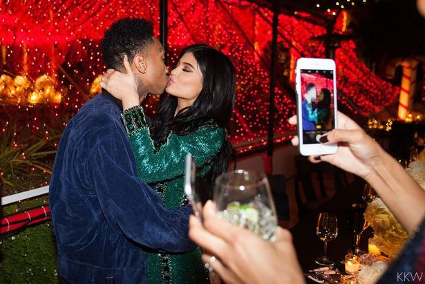 Tyga and Kylie kissing Kardashians Kristmas Eve party