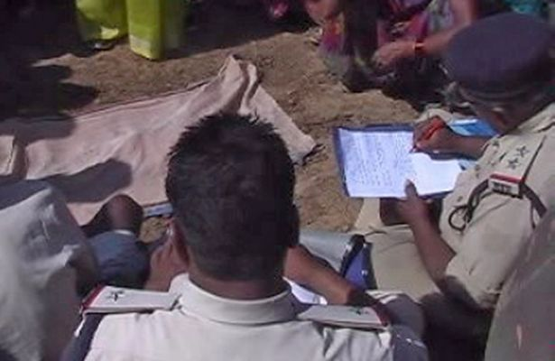 Police officers investigate at a construction site after Jai Ram,24, who was buried alive when construction workers failed to spot him in the dark and built over him at a dam project in Madhya Pradesh, India