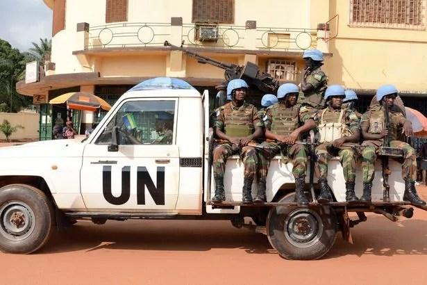 UN peacekeeping soldiers from Rwanda patrol
