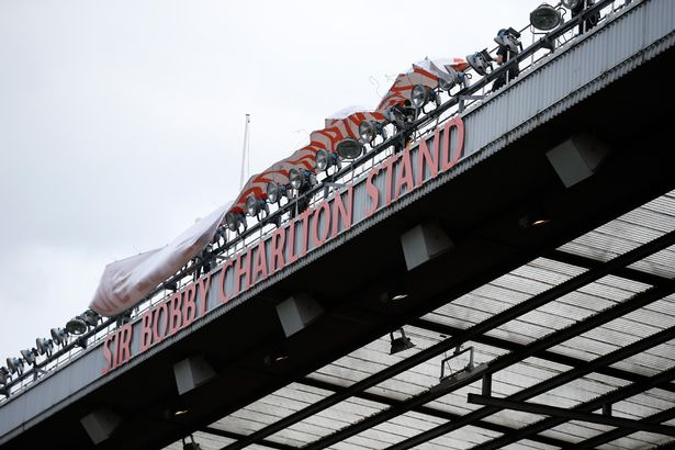 "The newly renamed South Stand ""Sir Bobby Charlton stand"" to commemorate the 60 year anniversary of his debut for Manchester United"