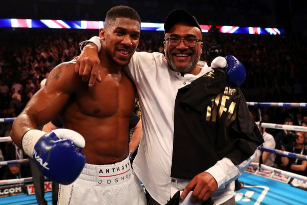 Anthony Joshua of England celebrates with his father Jonathan
