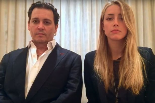 Amber Heard and Johnny Depp have issued a video apology for providing false documents when bringing their dogs Pistol and Boo into Australia