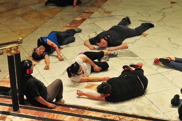 Emergency forces and shoppers take place in a simulated terror attack at the Trafford Centre