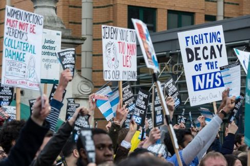 Placards are held in the air outside King's College Hospital as junior doctors strike