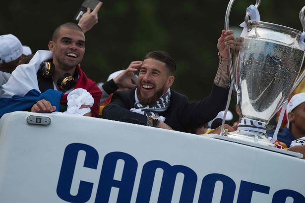 Real Madrid's defender Sergio Ramos and Real Madrid's Portuguese defender Pepe celebrate the team's win on Plaza Cibeles in Madrid on May 29, 2016