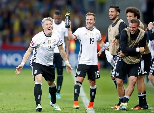Bastian Schweinsteiger celebrates with team mates after scoring the second
