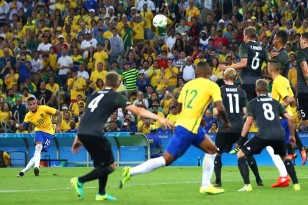 Neymar of Brazil scores the first Brazil goal during the Men's Football Final between Brazil and Germany
