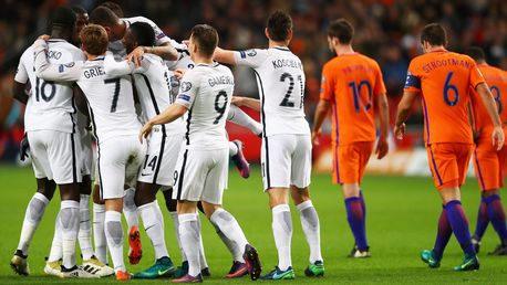 Paul Pogba is congratulated by teammates after scoring as Holland players walk away dejected