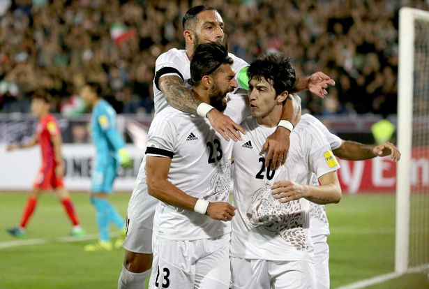 Iran's players congratulate Sardar Azmoun (R) after scoring their opening goal
