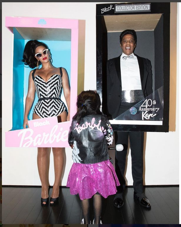 Jay Z looks pleased with his tux as Blue Ivy shows off her Barbie jacket