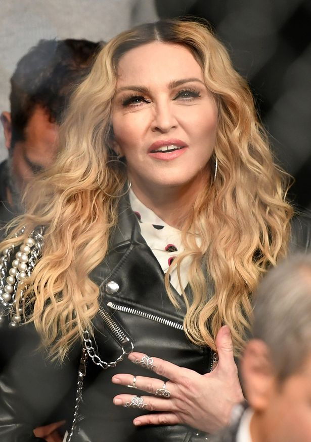 Music recording artist Madonna watches the middleweight bout between Chris Weidman of the United States and Yoel Romero of Cuba during the UFC 205 event at Madison Square Garden on November 12, 2016 in New York City