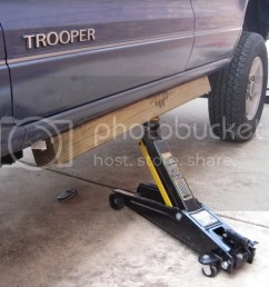 you use the front three factory bolts on the rear three holes trooper body jacked up on one side a 4x4 wood block is really handy [ 1024 x 768 Pixel ]