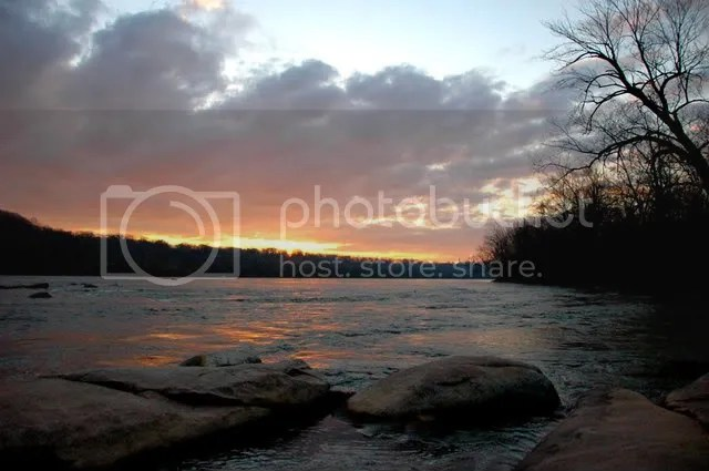 a photo of the james river at sunrise