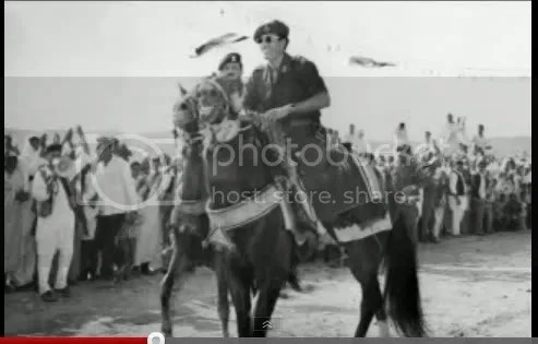 Gadhafi leads on horseback
